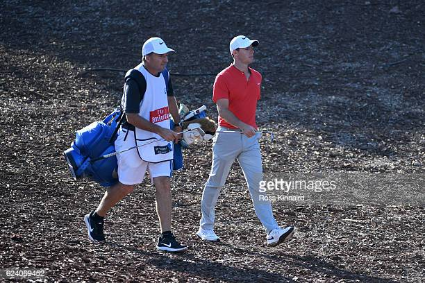 Rory McIlroy of Northern Ireland walks to the 4th green with caddie JP Fitzgerald during day two of the DP World Tour Championship at Jumeirah Golf...