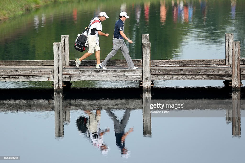 <a gi-track='captionPersonalityLinkClicked' href=/galleries/search?phrase=Rory+McIlroy&family=editorial&specificpeople=783109 ng-click='$event.stopPropagation()'>Rory McIlroy</a> of Northern Ireland walks to the fourth hole tee box across a foot bridge with his caddie J.P. Fitzgerald during the second round of the BMW Championship at Crooked Stick Golf Club on September 7, 2012 in Carmel, Indiana.
