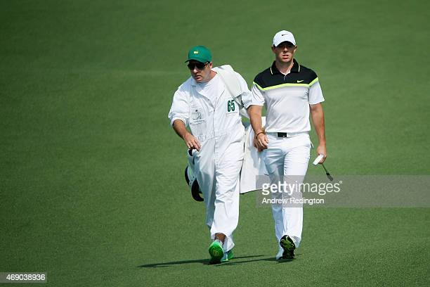 Rory McIlroy of Northern Ireland walks to the second green alongside his caddie JP Fitzgerald during the first round of the 2015 Masters Tournament...