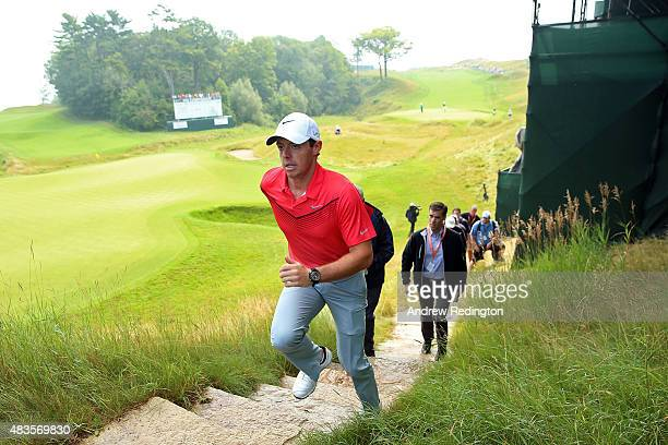 Rory McIlroy of Northern Ireland walks up a set of stairs after a practice round prior to the 2015 PGA Championship at Whistling Straits on on August...
