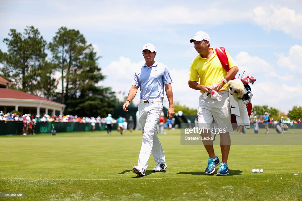 Rory McIlroy of Northern Ireland walks with caddie J.P. Fitzgerald across the practice range during a practice round prior to the start of the 114th U.S. Open at Pinehurst Resort & Country Club, Course No. 2 on June 11, 2014 in Pinehurst, North Carolina.