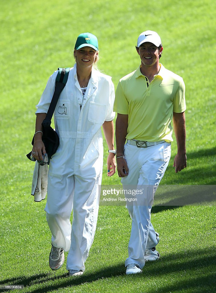 <a gi-track='captionPersonalityLinkClicked' href=/galleries/search?phrase=Rory+McIlroy&family=editorial&specificpeople=783109 ng-click='$event.stopPropagation()'>Rory McIlroy</a> of Northern Ireland walks with his caddie <a gi-track='captionPersonalityLinkClicked' href=/galleries/search?phrase=Caroline+Wozniacki&family=editorial&specificpeople=740679 ng-click='$event.stopPropagation()'>Caroline Wozniacki</a> during the Par 3 Contest prior to the start of the 2013 Masters Tournament at Augusta National Golf Club on April 10, 2013 in Augusta, Georgia.