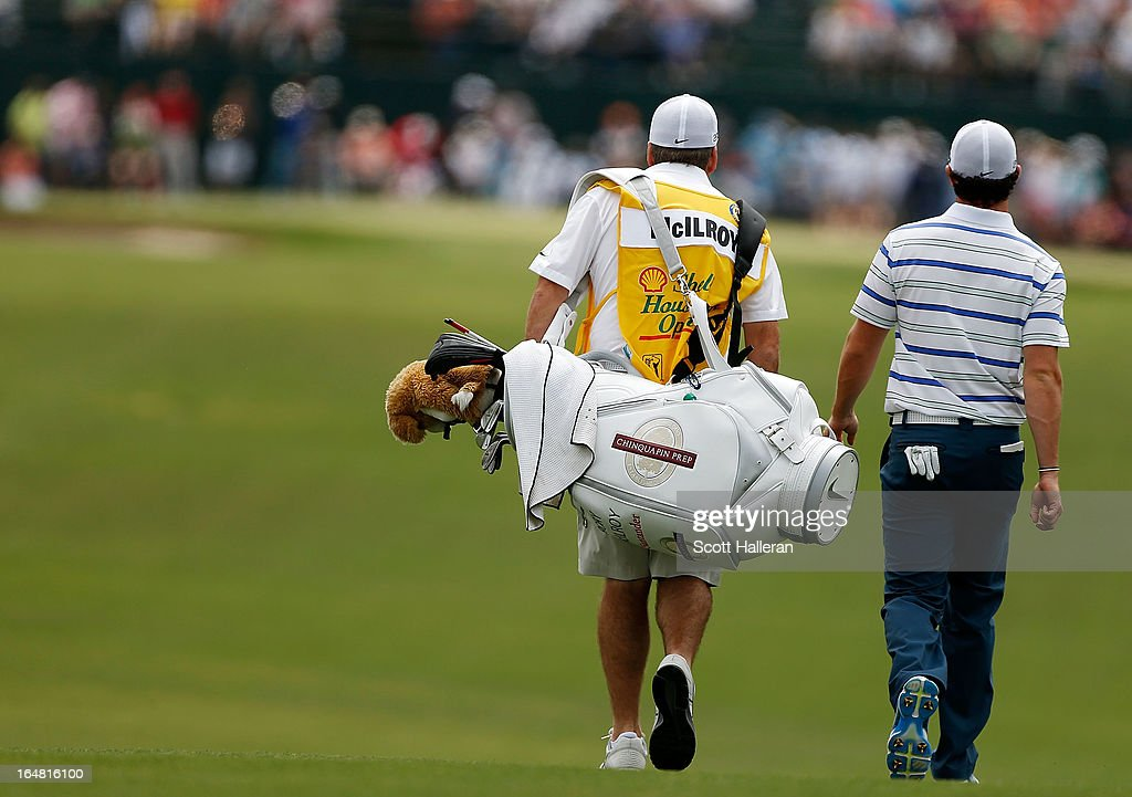 Rory McIlroy of Northern Ireland walks with his caddie J.P. Fitzgerald on the first hole during the first round of the Shell Houston Open at the Redstone Golf Club on March 28, 2013 in Humble, Texas.