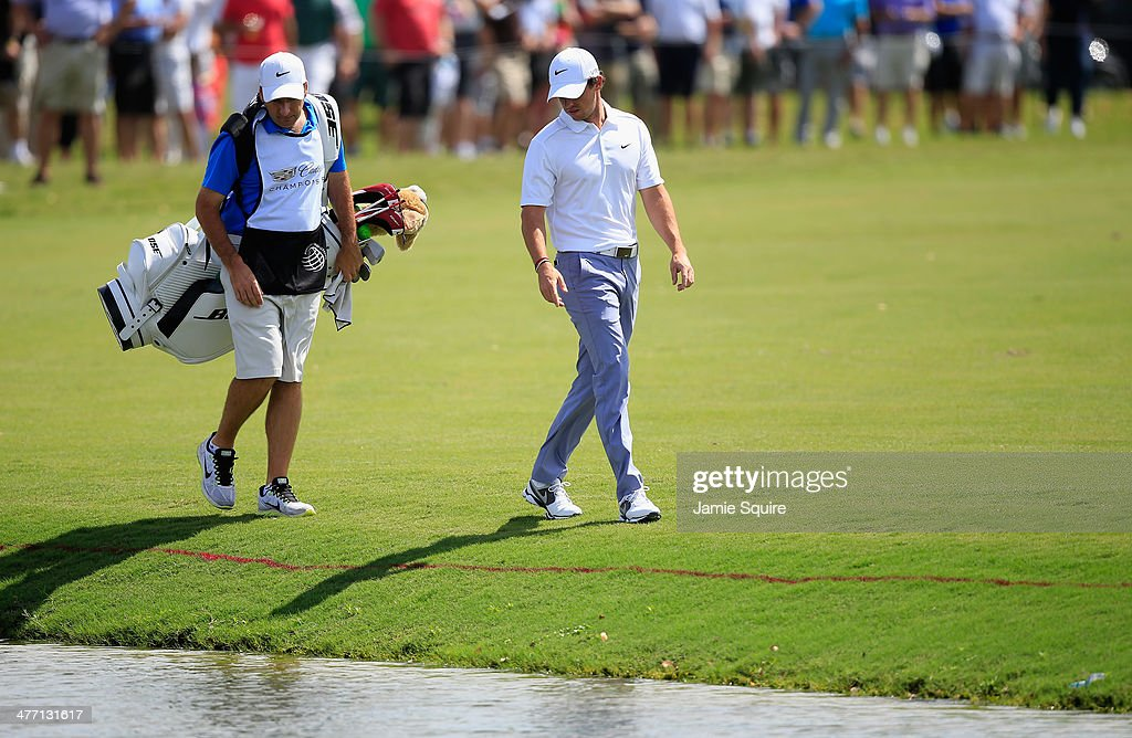 <a gi-track='captionPersonalityLinkClicked' href=/galleries/search?phrase=Rory+McIlroy&family=editorial&specificpeople=783109 ng-click='$event.stopPropagation()'>Rory McIlroy</a> of Northern Ireland walks with his caddie J.P. Fitzgerald after hitting into the water on the first hole during the second round of the World Golf Championships-Cadillac Championship at Trump National Doral on March 7, 2014 in Doral, Florida.