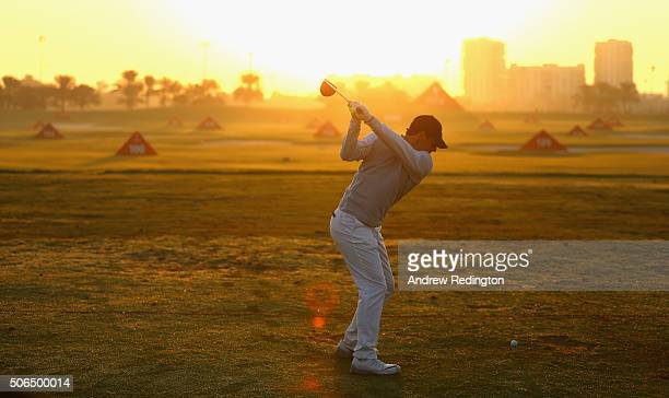 Rory McIlroy of Northern Ireland warms up on the practice range during the continuation of the third round of the Abu Dhabi HSBC Golf Championship at...