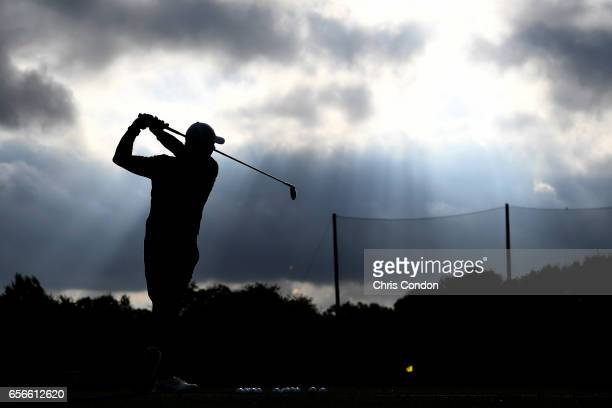 Rory McIlroy of Northern Ireland warms up on the range during the first round of the World Golf Championships Dell Technologies Match Play at Austin...