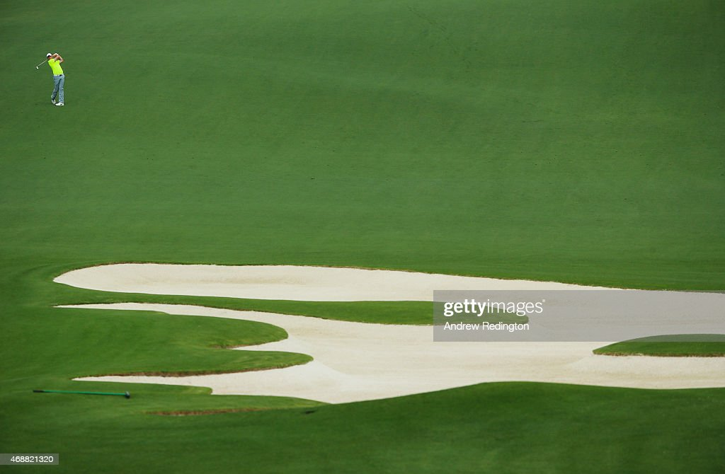 Rory McIlroy of Northern Ireland watches a shot during a practice round prior to the start of the 2015 Masters Tournament at Augusta National Golf Club on April 7, 2015 in Augusta, Georgia.
