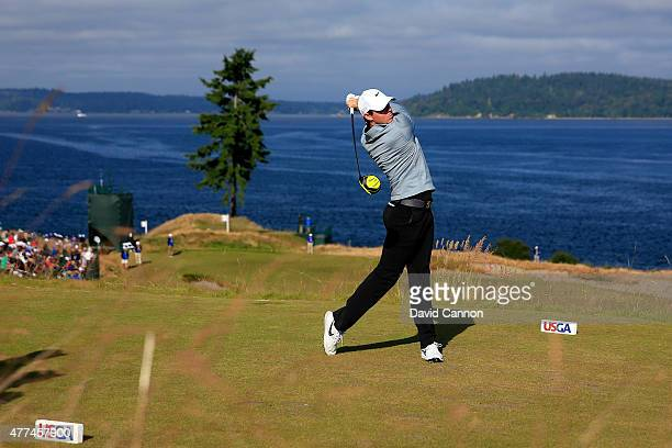 Rory McIlroy of Northern Ireland watches a tee shot during a practice round prior to the start of the 115th US Open Championship at Chambers Bay on...