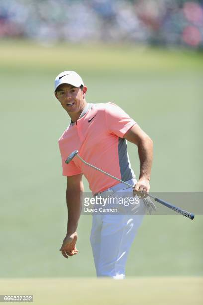 Rory McIlroy of Northern Ireland watches his long putt on the first hole during the final round of the 2017 Masters Tournament at Augusta National...