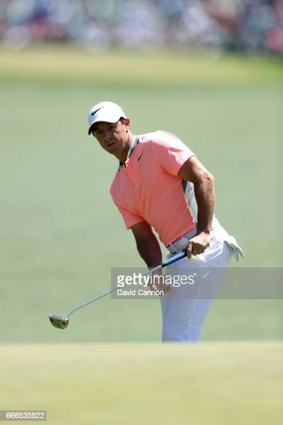Rory McIlroy of Northern Ireland watches his putt on the first hole during the final round of the 2017 Masters Tournament at Augusta National Golf...