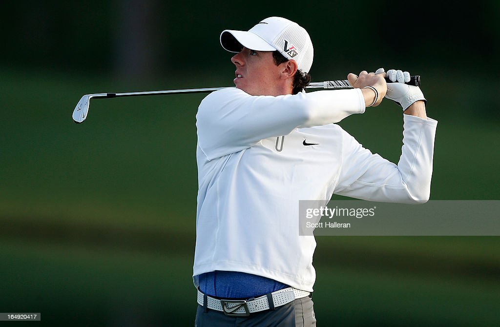 Rory McIlroy of Northern Ireland watches his second shot on the 11th hole during the second round of the Shell Houston Open at the Redstone Golf Club...