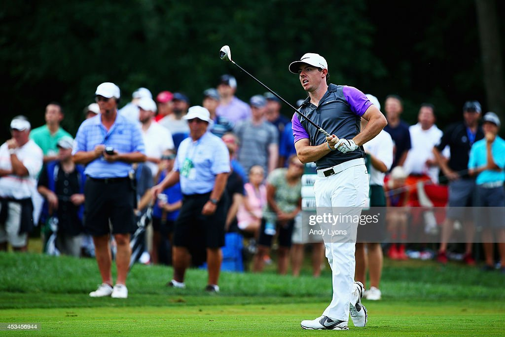 Rory McIlroy of Northern Ireland watches his second shot on the tenth hole during the final round of the 96th PGA Championship at Valhalla Golf Club...