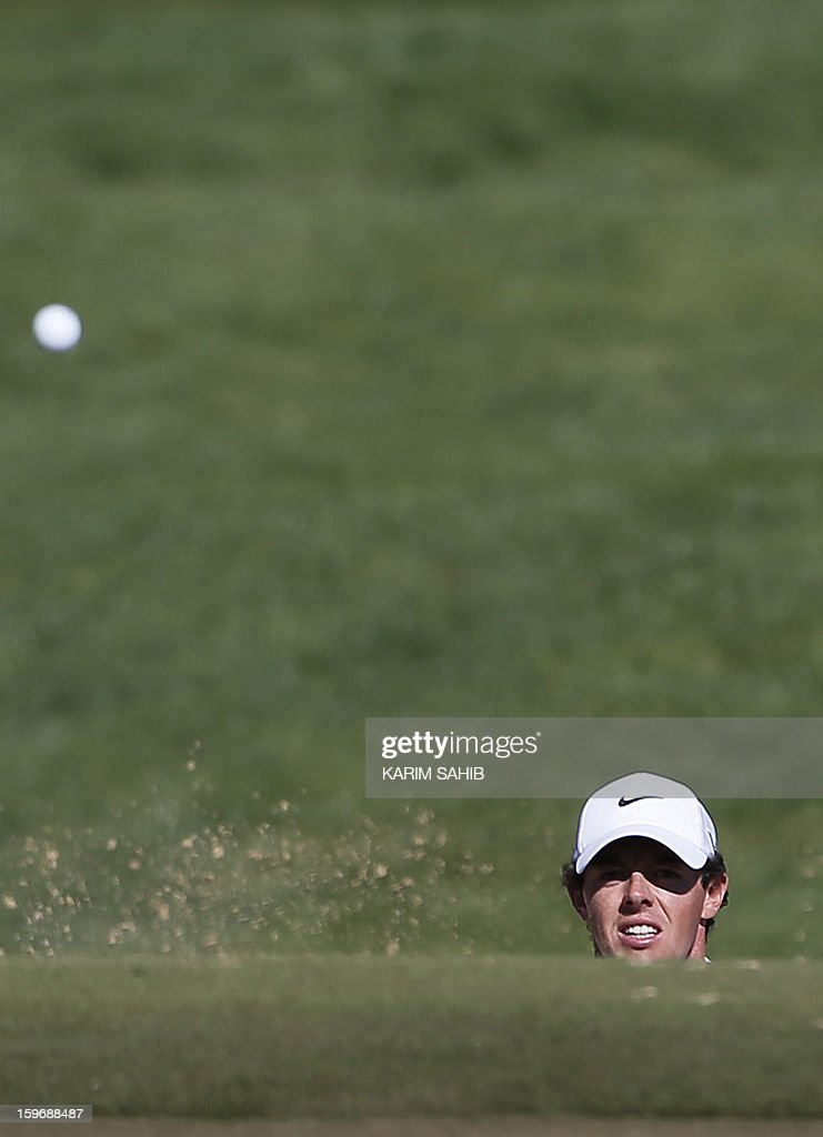 Rory McIlroy of Northern Ireland watches his shot during the second round of the Abu Dhabi Golf Championship at the Abu Dhabi Golf Club in the Emirati capital on January 18, 2013.