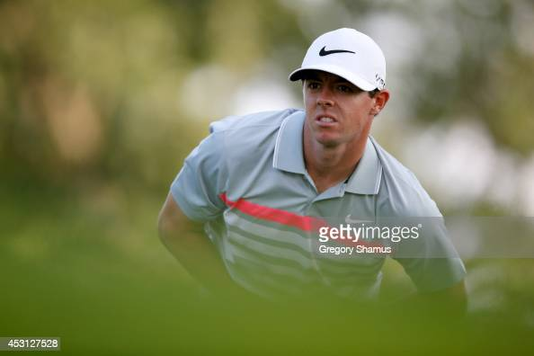 Rory McIlroy of Northern Ireland watches his shot off the 15th tee during the final round of the World Golf ChampionshipsBridgestone Invitational at...