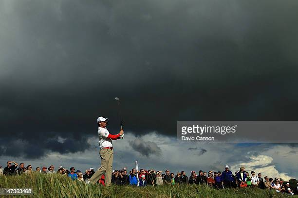 Rory McIlroy of Northern Ireland watches his tee shot at the par 3 14th hole 'Calamity' during the first round of the 2012 Irish Open held on the...