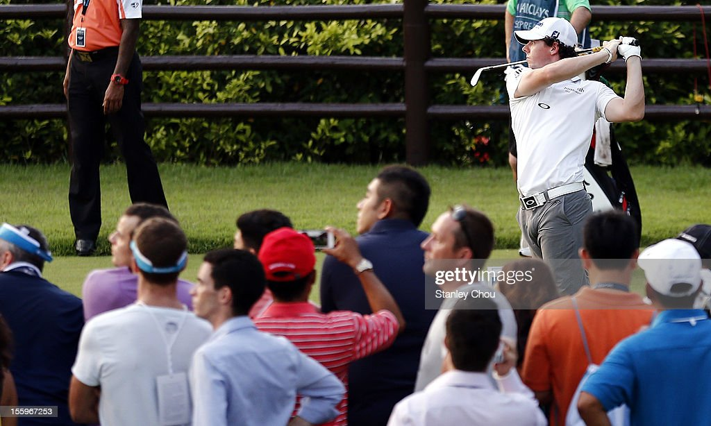 <a gi-track='captionPersonalityLinkClicked' href=/galleries/search?phrase=Rory+McIlroy&family=editorial&specificpeople=783109 ng-click='$event.stopPropagation()'>Rory McIlroy</a> of Northern Ireland watches his tee shot on the 7th tee during the 3rd round of the Barclays Singapore Open at the Sentosa Golf Club on November 10, 2012 in Singapore.