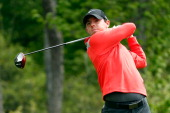 Rory McIlroy of Northern Ireland watches his tee shot on the thirteenth hole during round three of the Shell Houston Open at the Golf Club of Houston...