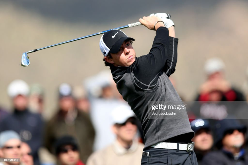 Rory McIlroy of Northern Ireland watches his tee shot on the third hole during the first round of the World Golf Championships - Accenture Match Play at the Golf Club at Dove Mountain on February 21, 2013 in Marana, Arizona. Round one play was suspended on February 20 due to inclimate weather and is scheduled to be continued today.