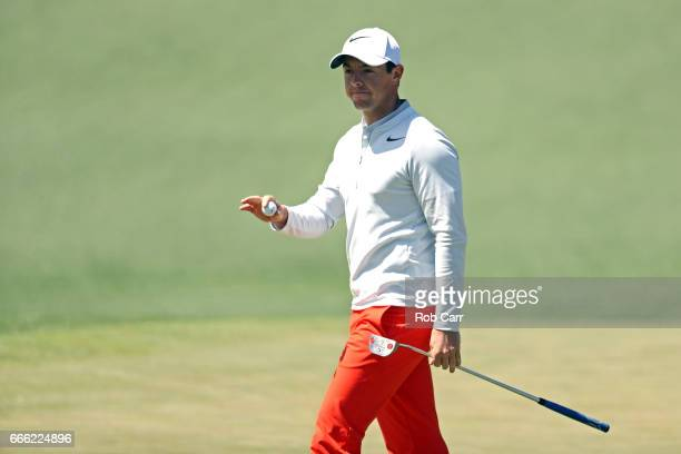 Rory McIlroy of Northern Ireland waves after making a putt for birdie on the second hole during the third round of the 2017 Masters Tournament at...