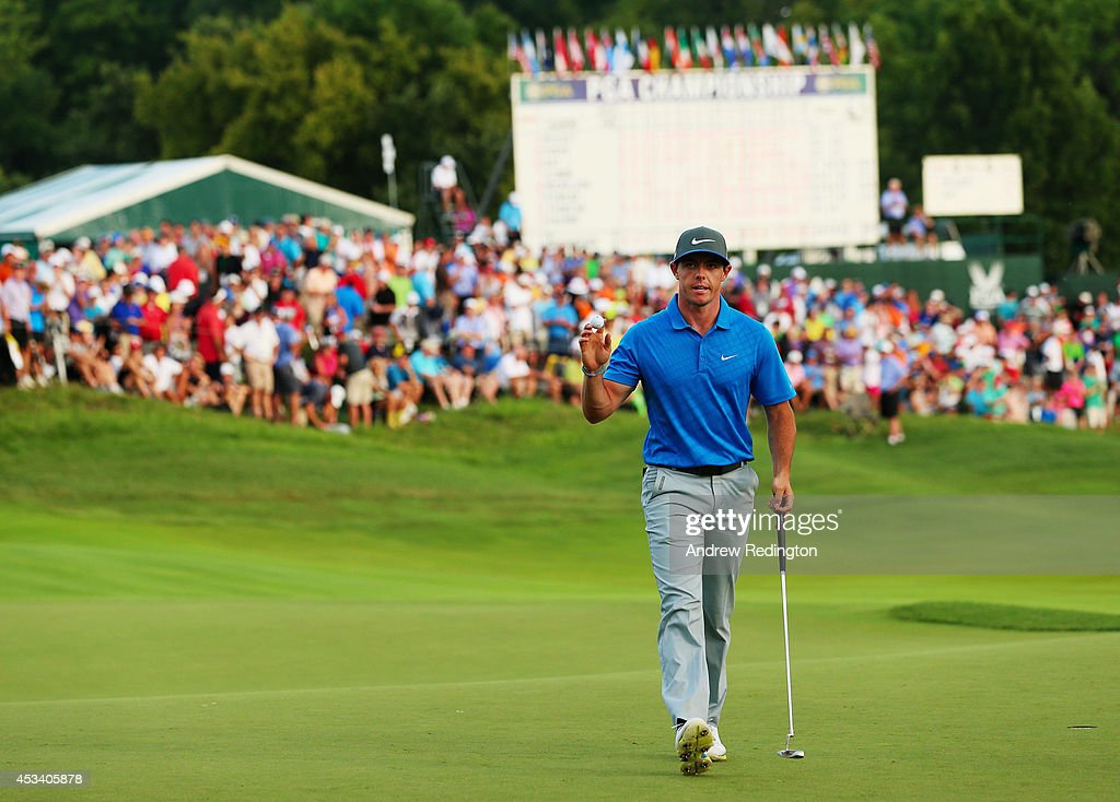 <a gi-track='captionPersonalityLinkClicked' href=/galleries/search?phrase=Rory+McIlroy&family=editorial&specificpeople=783109 ng-click='$event.stopPropagation()'>Rory McIlroy</a> of Northern Ireland waves to fans after making a putt for birdie on the 18th green to finish with a four-under par 67 during the third round of the 96th PGA Championship at Valhalla Golf Club on August 9, 2014 in Louisville, Kentucky.