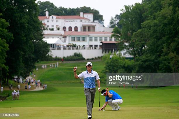 Rory McIlroy of Northern Ireland waves to the gallery after a birdie putt on the 11th green as YE Yang of South Korea looks on during the third round...