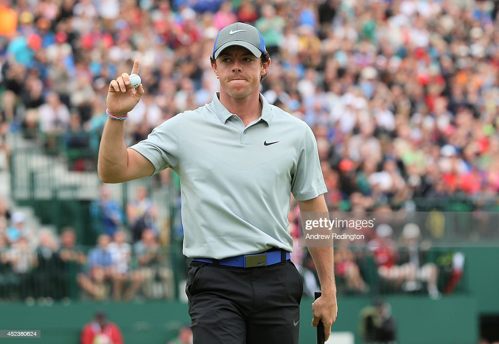 Rory McIlroy of Northern Ireland waves to the gallery on the 18th green after a fourunder par 68 during the third round of The 143rd Open...