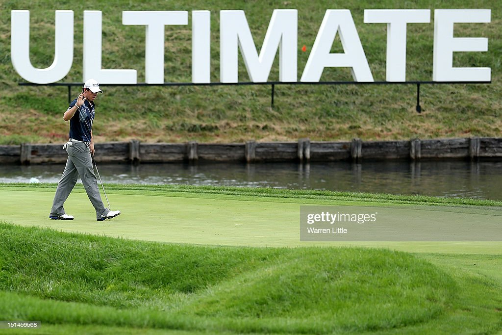 <a gi-track='captionPersonalityLinkClicked' href=/galleries/search?phrase=Rory+McIlroy&family=editorial&specificpeople=783109 ng-click='$event.stopPropagation()'>Rory McIlroy</a> of Northern Ireland waves to the gallery on the 18th green during the second round of the BMW Championship at Crooked Stick Golf Club on September 7, 2012 in Carmel, Indiana.