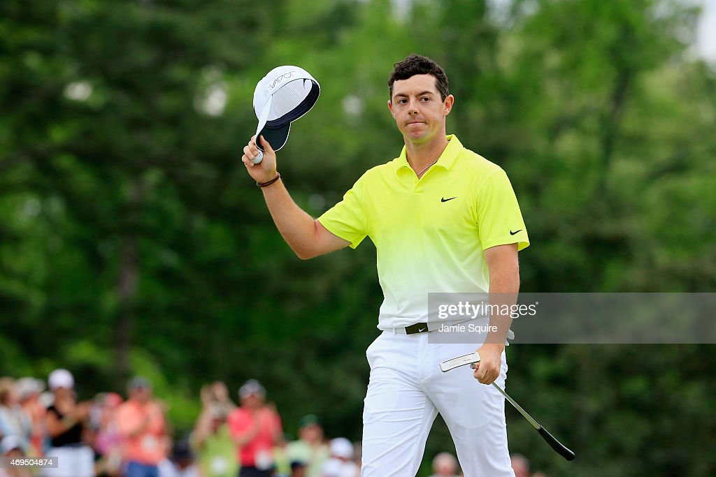 Rory McIlroy of Northern Ireland waves to the gallery on the 18th green during the final round of the 2015 Masters Tournament at Augusta National...