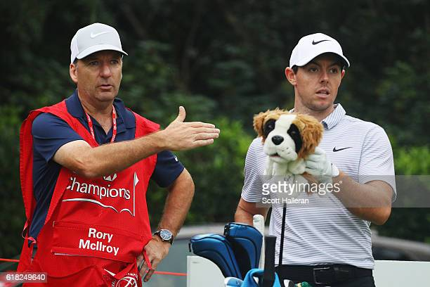 Rory McIlroy of Northern Ireland with his caddie JP Fitzgerald during practice prior to the start of the WGC HSBC Champions at the Sheshan...