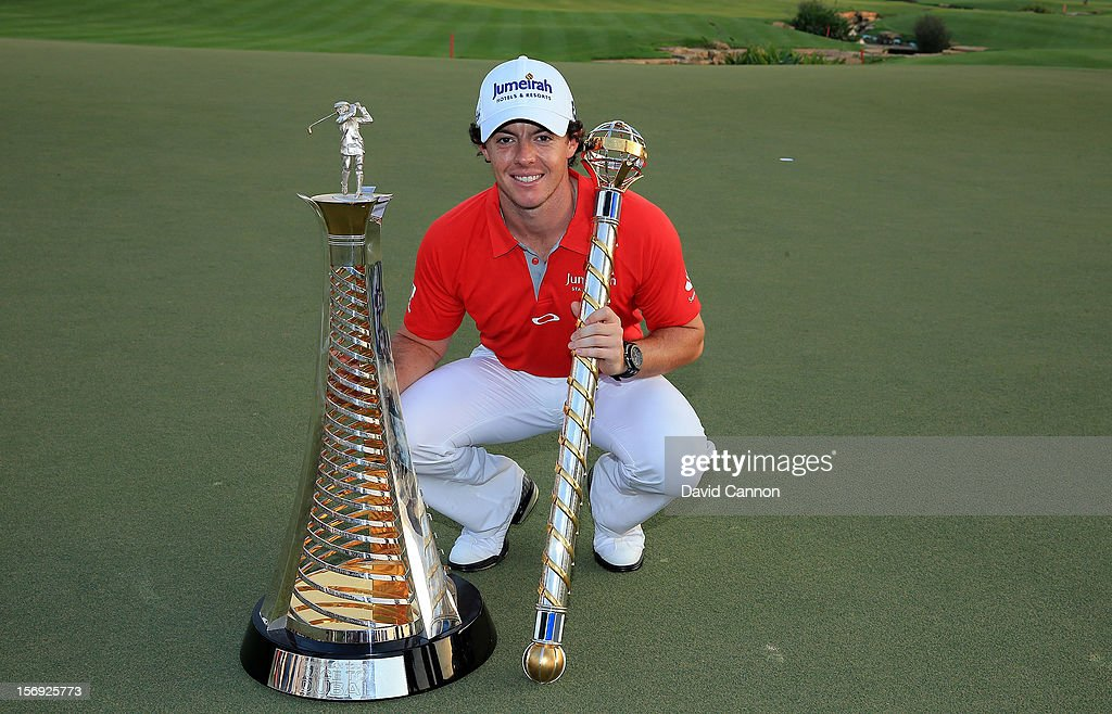<a gi-track='captionPersonalityLinkClicked' href=/galleries/search?phrase=Rory+McIlroy&family=editorial&specificpeople=783109 ng-click='$event.stopPropagation()'>Rory McIlroy</a> of Northern Ireland with the DP World Tour Championship Trophy and the Race to Dubai Trophy (l) after his win during the final round of the 2012 DP World Tour Championship on the Earth Course at Jumeirah Golf Estates on November 25, 2012 in Dubai, United Arab Emirates.