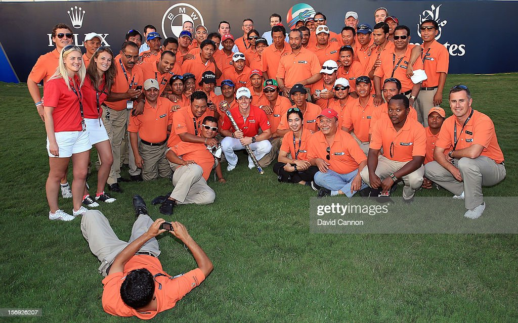 Rory McIlroy of Northern Ireland with the DP World Tour Championship Trophy Jumeirah Golf Estates grounds crew and staff after his win during the final round of the 2012 DP World Tour Championship on the Earth Course at Jumeirah Golf Estates on November 25, 2012 in Dubai, United Arab Emirates.