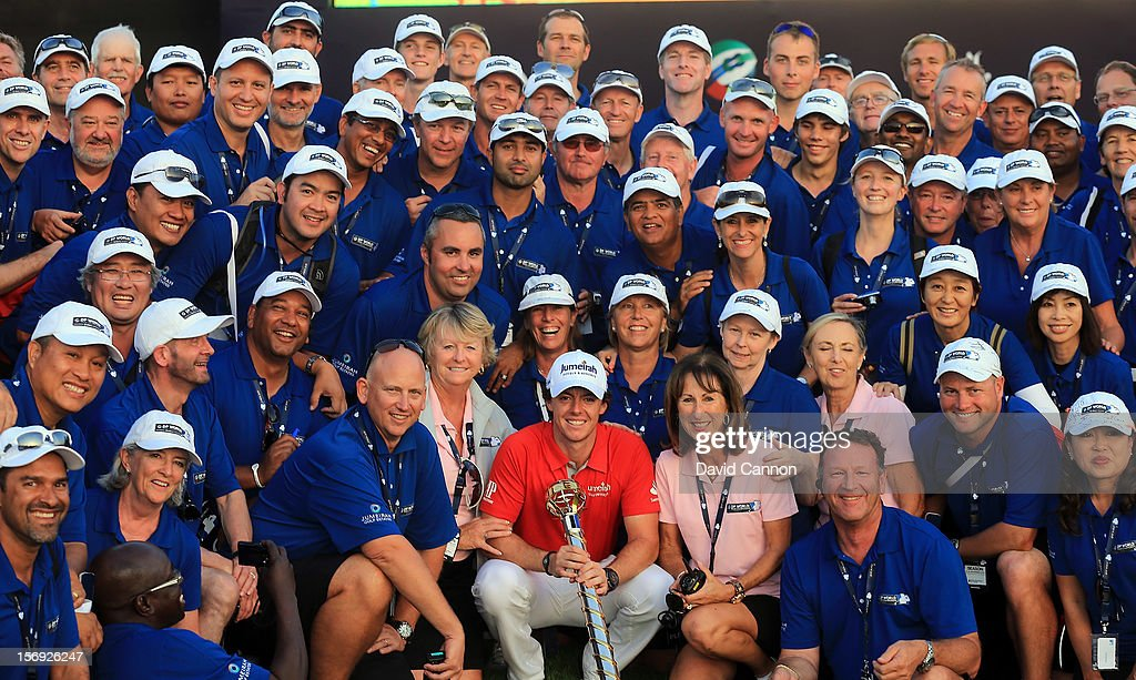 Rory McIlroy of Northern Ireland with the DP World Tour Championship Trophy and a group of tournament marshalls after his win during the final round of the 2012 DP World Tour Championship on the Earth Course at Jumeirah Golf Estates on November 25, 2012 in Dubai, United Arab Emirates.