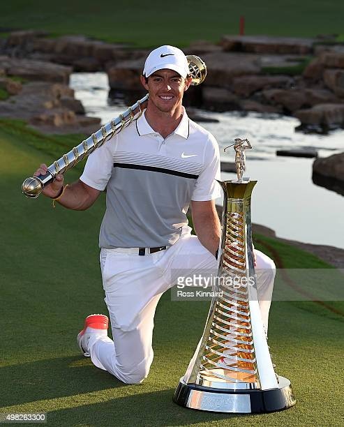 Rory McIlroy of Northern Ireland with the DP World Tour Championship Trophy and the Race to Dubai Trophy after the final round of the DP World Tour...