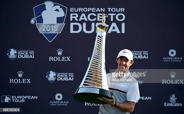 Rory McIlroy of Northern Ireland with the Race to Dubai Trophy after the final round of the DP World Tour Championship on the Earth Course at...