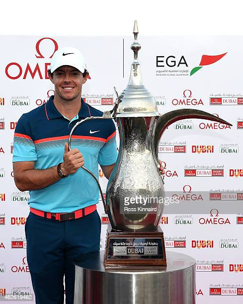 Rory McIlroy of Northern Ireland with the winners trophy after the final round of the Omega Dubai Desert Classic at the Emirates Golf Club on...