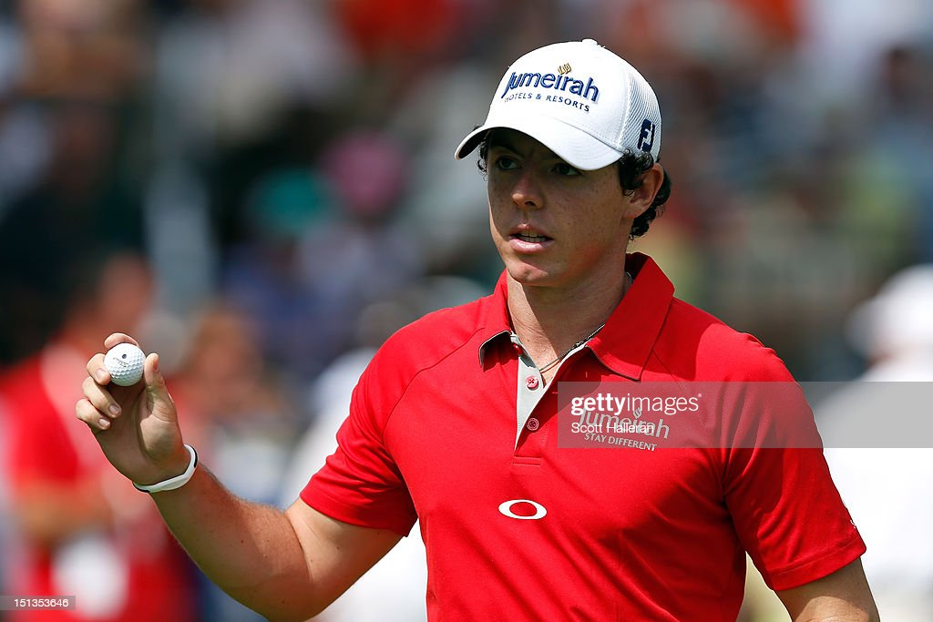 <a gi-track='captionPersonalityLinkClicked' href=/galleries/search?phrase=Rory+McIlroy&family=editorial&specificpeople=783109 ng-click='$event.stopPropagation()'>Rory McIlroy</a> of Northern Irelandreacts after he made a birdie putt on the 10th hole green during the first round of the BMW Championship at Crooked Stick Golf Club on September 6, 2012 in Carmel, Indiana.