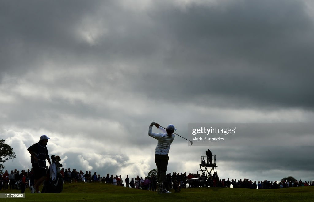 <a gi-track='captionPersonalityLinkClicked' href=/galleries/search?phrase=Rory+McIlroy&family=editorial&specificpeople=783109 ng-click='$event.stopPropagation()'>Rory McIlroy</a> of Northern Iriland plays his approach shot to the 18th during the Second Round of the Irish Open at Carton House Golf Club on June 28, 2013 in Maynooth, Ireland.