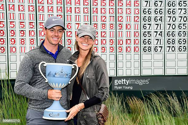 Rory McIlroy poses for a picture with his fiancé Erica Stoll with the Deutsche Bank Championship trophy following the final round of the Deutsche...