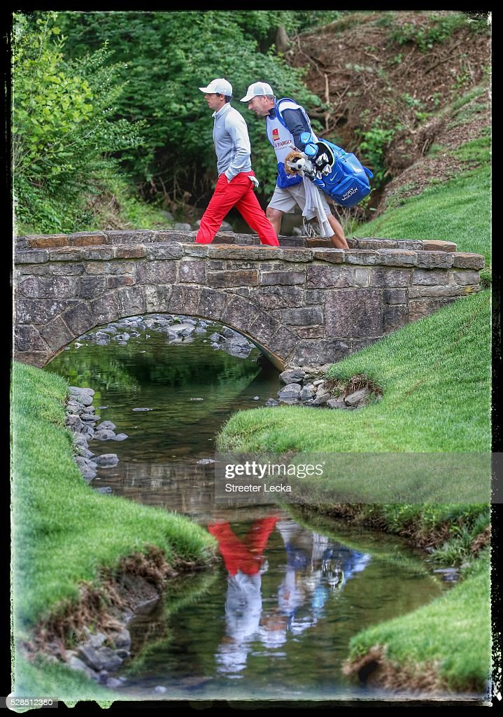 Rory McIlroy walks across the bridge on the 13th hole during the first round of the 2016 Wells Fargo Championship at Quail Hollow Club on May 5, 2016 in Charlotte, North Carolina.
