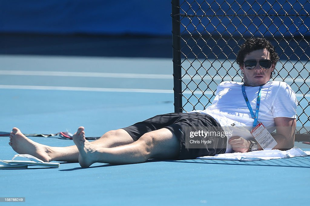 Rory McIlroy watches Caroline Wozniacki during a practice session on December 29, 2012 in Brisbane, Australia.