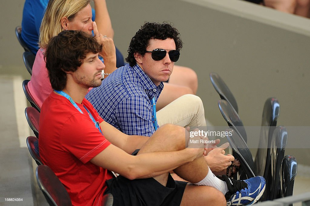 Rory McIlroy (C) watches the match between Caroline Wozniacki of Denmark and Ksenia Pervak of Kazakhstan during day two of the Brisbane International at Pat Rafter Arena on December 31, 2012 in Brisbane, Australia.