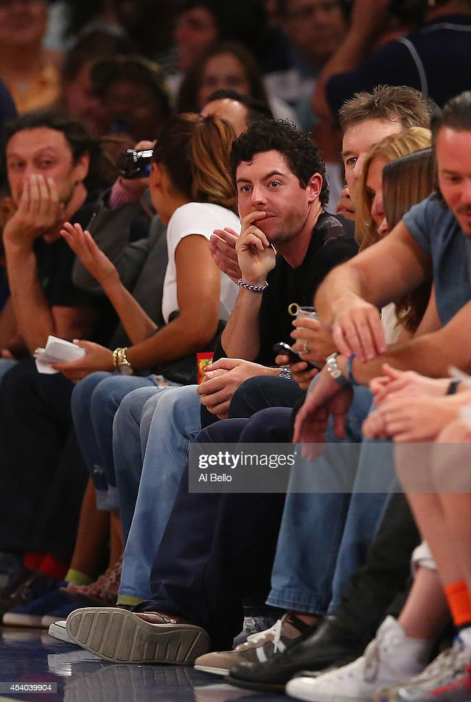 <a gi-track='captionPersonalityLinkClicked' href=/galleries/search?phrase=Rory+McIlroy&family=editorial&specificpeople=783109 ng-click='$event.stopPropagation()'>Rory McIlroy</a> watches the USA agaainst Puerto Rico game at Madison Square Garden on August 22, 2014 in New York City.