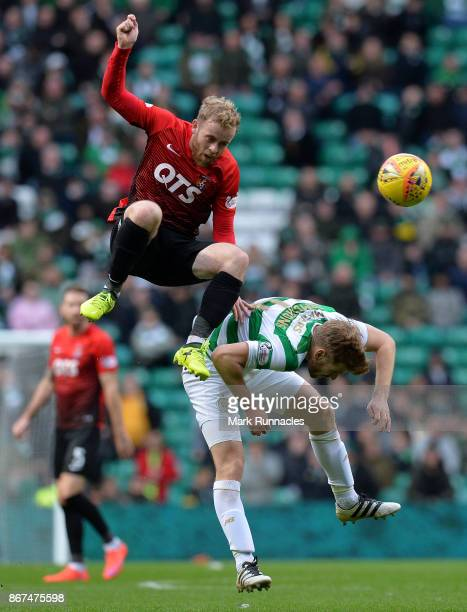 Rory McKenzie of Kilmarnock challenges Stuart Armstrong of Celtic during the Ladbrokes Scottish Premiership match between Celtic and Kilmarnock at...