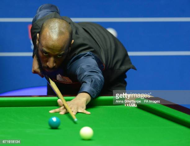Rory McLeod at the table in his match against Stephen Maguire on day nine of the Betfred Snooker World Championships at the Crucible Theatre Sheffield