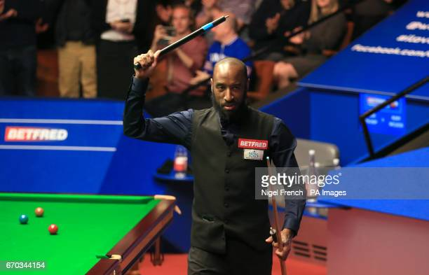 Rory McLeod celebrates after his victory over Judd Trump on day five of the Betfred Snooker World Championships at the Crucible Theatre Sheffield
