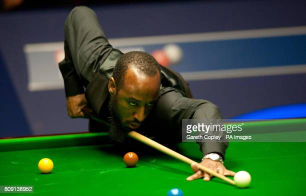 Rory McLeod in action against John Higgins during their second round match of the Betfredcom World Snooker Championships at the Crucible Sheffield