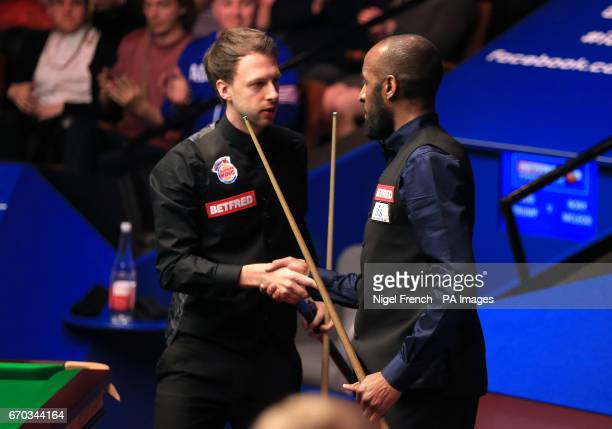 Rory McLeod is congratulated after his victory over Judd Trump on day five of the Betfred Snooker World Championships at the Crucible Theatre...