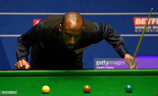 Rory McLeod of England lines up a shot against Judd Trump during their first round match of the World Snooker Championship at Crucible Theatre on...