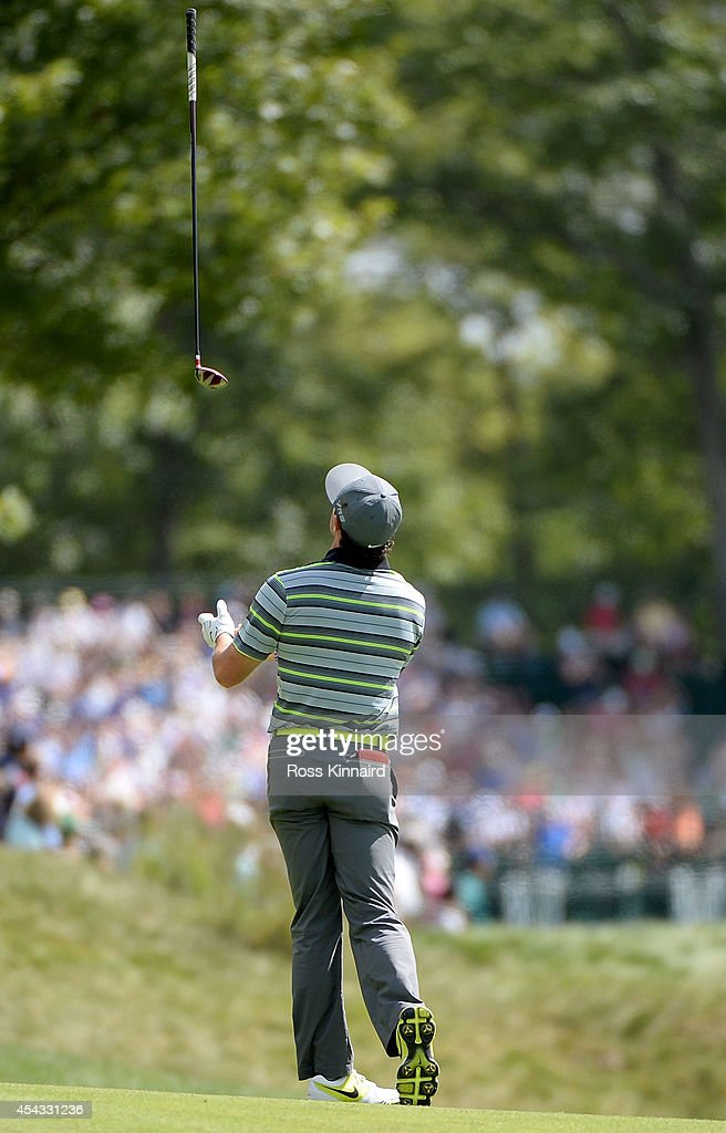 Rory Mcllroy of Northern Ireland throws his club in the air after his second shot on the 18th during the first round of the Deutsche Bank...