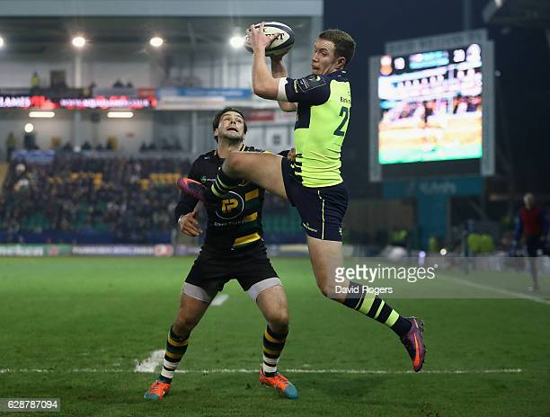 Rory O'Loughlin of Leinster beats Ben Foden to the high ball to score a try during the European Rugby Champions Cup match between Northampton Saints...